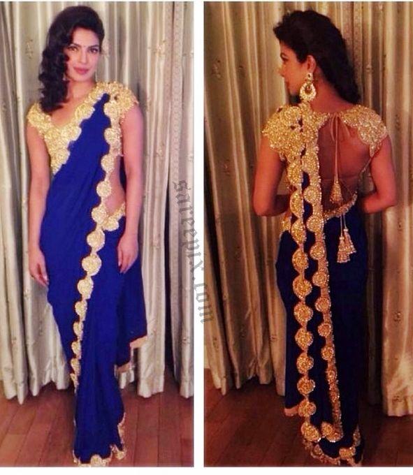 Priyanka chopra in saree photos at Salman's sister wedding ceremony. The pear shaped beauty was awesome in Abu jani sandeep khosla blue saree, backcless.