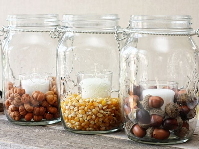 Create a varied autumnal arrangement by filling hanging Mason jars with acorns, popcorn kernels, or mini pumpkin pods.