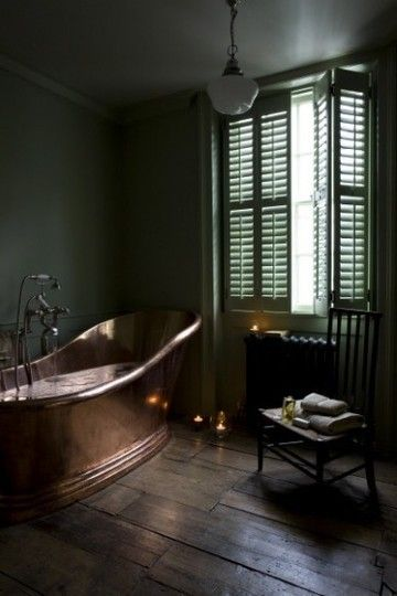 Copper tub, soft green walls, old wood floor and plantation shutters...yes please.