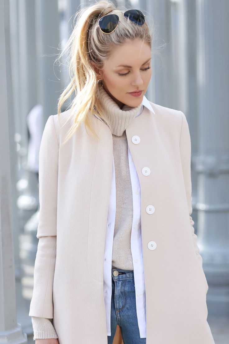 pink coat jeans pants and sweater