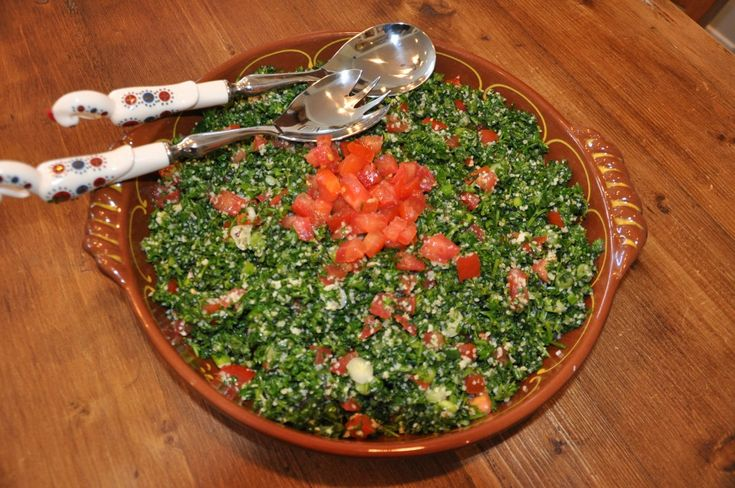 Tabbouleh 1/2 cup bulgur, fine cracked wheat juice of 4-5 lemons 3 bunches fresh parsley, finely chopped handful fresh mint, finely sliced (optional) 3 medium tomatoes, diced 6 green onions, thinly sliced (with green stems) 1/2 cup extra virgin olive oil salt (to taste)