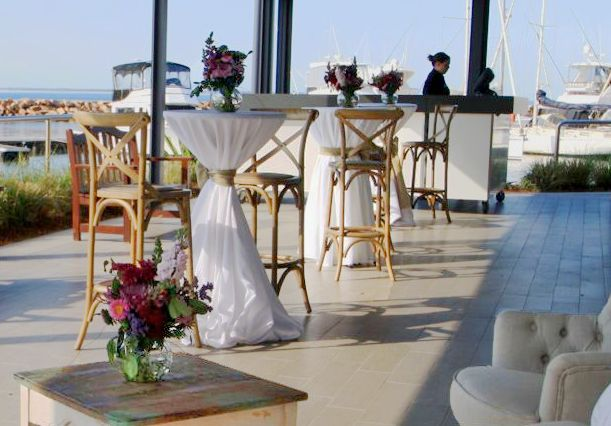 Hamptons at The Anchorage, timber cross back bar stools, cocktails draped in crisp white linens and french provincial lounge