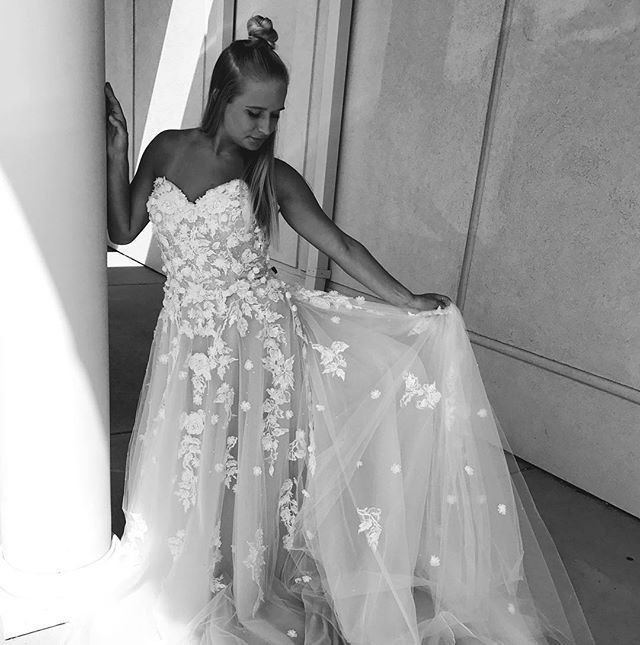 NEW ARRIVAL // Strapless soft tulle ball gown featuring sweetheart neckline and embroidered lace appliqués. Three dimensional flowers accent the bodice and cascade down the a-line skirt. Covered button details along the back. (Style: 8171 | Designer: Mori Lee) #MichellesBride #Syttd #NewArrival