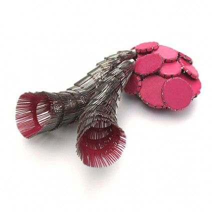 """Sephimera"".  Brooch by Mirjam Hiller.  Stainless steel powder coated."
