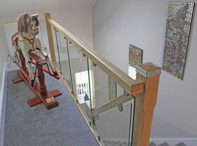 solid oak balustrade with toughened glass,Upton.Wirral