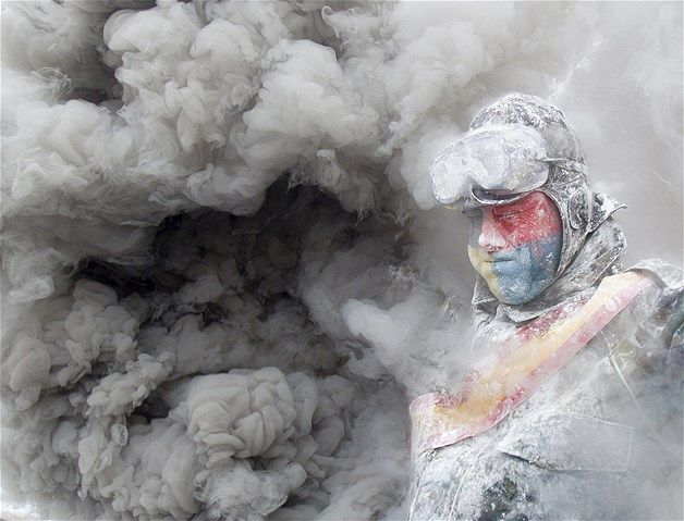 Jan. 3, 2014: A reveler in a mock military uniform takes part in the battle of Enfarinats, a flour fight in Ibi, Spain, on Dec. 28. The citizens annually celebrate Els Enfarinats, a 200-year-old festival that is part of the Day of the Innocents, with a battle using flour, eggs and firecrackers outside city hall.