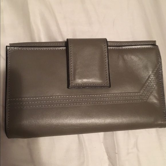 Grey rolfs wallet NWOT! Adorable grey Rolfs wallet. So versatile and never used! Snap shut with plenty of space for a checkbook and cards. Make me an offer  Macy's Bags Wallets
