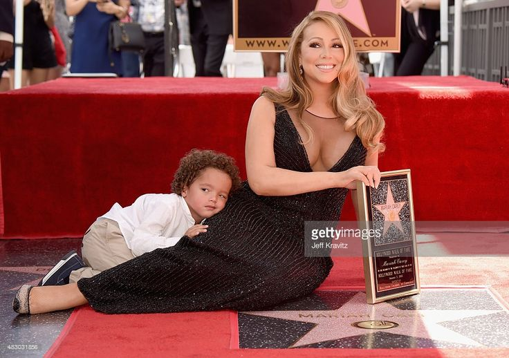 Singer Mariah Carey (R), with Moroccan Cannon, is honored with Star on The Hollywood Walk of Fame on August 5, 2015 in Hollywood, California.
