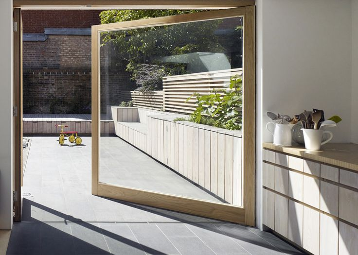 Hayhurst and Co. adds beach house-inspired extension to London home - I would love to have a massive door like that
