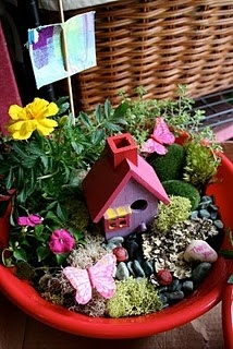 fairy garden in a pot ... going to do this w my 3 girls