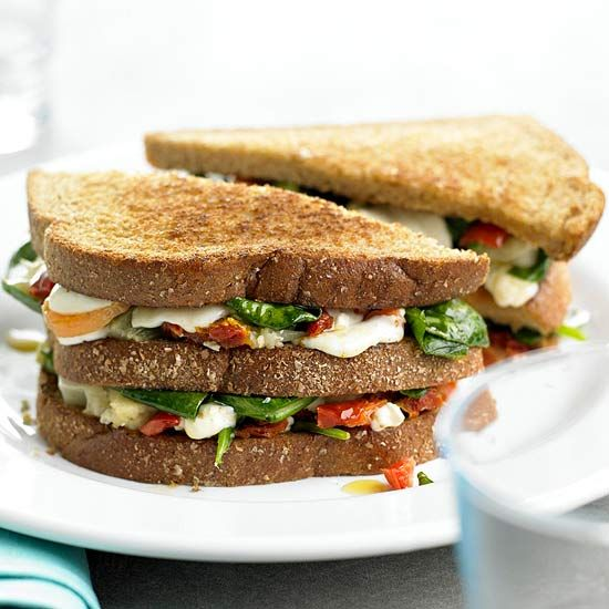For a healthier, still satisfying version of grilled cheese, top whole grain bread with fresh baby spinach, dried tomatoes, mozzarella, and pickled vegetables for our Veggie Grilled Cheese. More lunch recipes: http://www.bhg.com/recipes/salads/ideas/lunch-recipes #myplate #grains