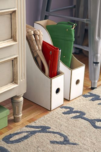 Magazine holders to store clutch purses