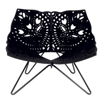 Louise Campbell Prince Chair  Materials:  Laser cutted neoprene rubber, felt, steel tube, sheet steel - powdercoated.