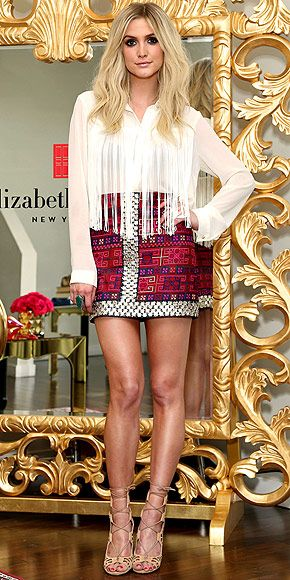"""If you looked up """"boho chic"""" in the dictionary, you'd probably find this photo of Ashlee wearing a fringe, button-down Asos blouse, embellished Sachin + Babi mini, lace-up Shoemint sandals and one hell of a cocktail ring for a visit to the Elizabeth Arden Beautiful Color Lip Lounge in Hollywood, Calif."""