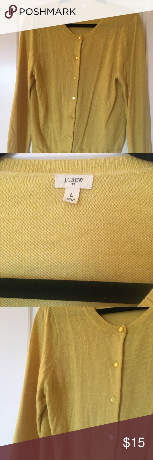 "Pretty Gold Yellow J Crew Factory Cardigan Size L Very pretty and unique gold/yellow cardigan from J Crew Factory! Size L, made of viscose/nylon/wool/alpaca, and super cute on! Throw it over a button-up, a t-shirt, or wear it buttoned up on its own! Not a color seen very often, it's a gorgeous light golden yellow, and would look beautiful in any season. Slight signs of wear under arms, but that's pretty typical for items made of wool, all it needs is a minor ""shaving"" to remove any of the…"
