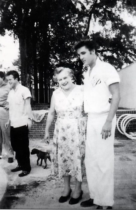 """August 9, 1957: Actor Nick Adams (""""Rebel Without a Cause"""") and his mother, Catherine Adamshock (neé Kutz, April 17, 1010 – March 1995), visit Elvis and his parents at Graceland. Elvis wearing his monogrammed shirt and Nick's mom Catherine Adamshock are pictured by the pool."""