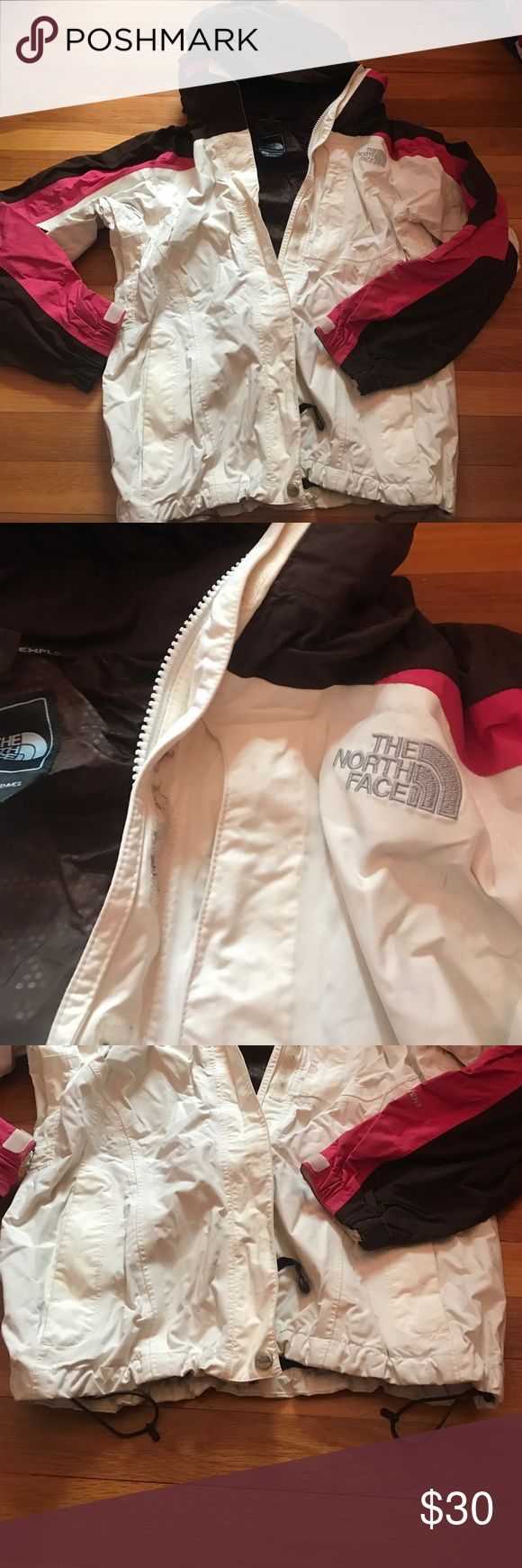 North face winter jacket Good used condition- some discoloration on the white and wear in the Velcro. Size medium from north face; pockets on sides and in arms, inner pocket; adjustments on sleeves and bottom North Face Jackets & Coats