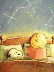 Charlie Brown reads a bedtime story to Snoopy.