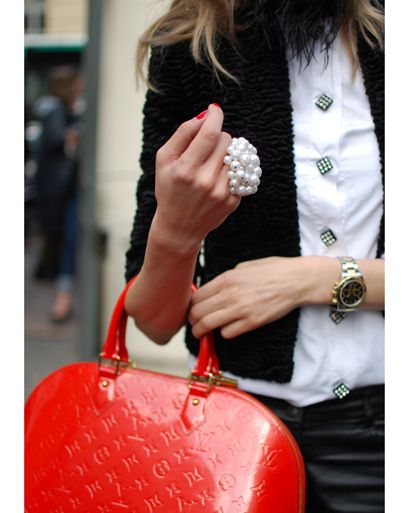 Grown up outfit but her bag, ring and nails do a total change to a young stylish girl