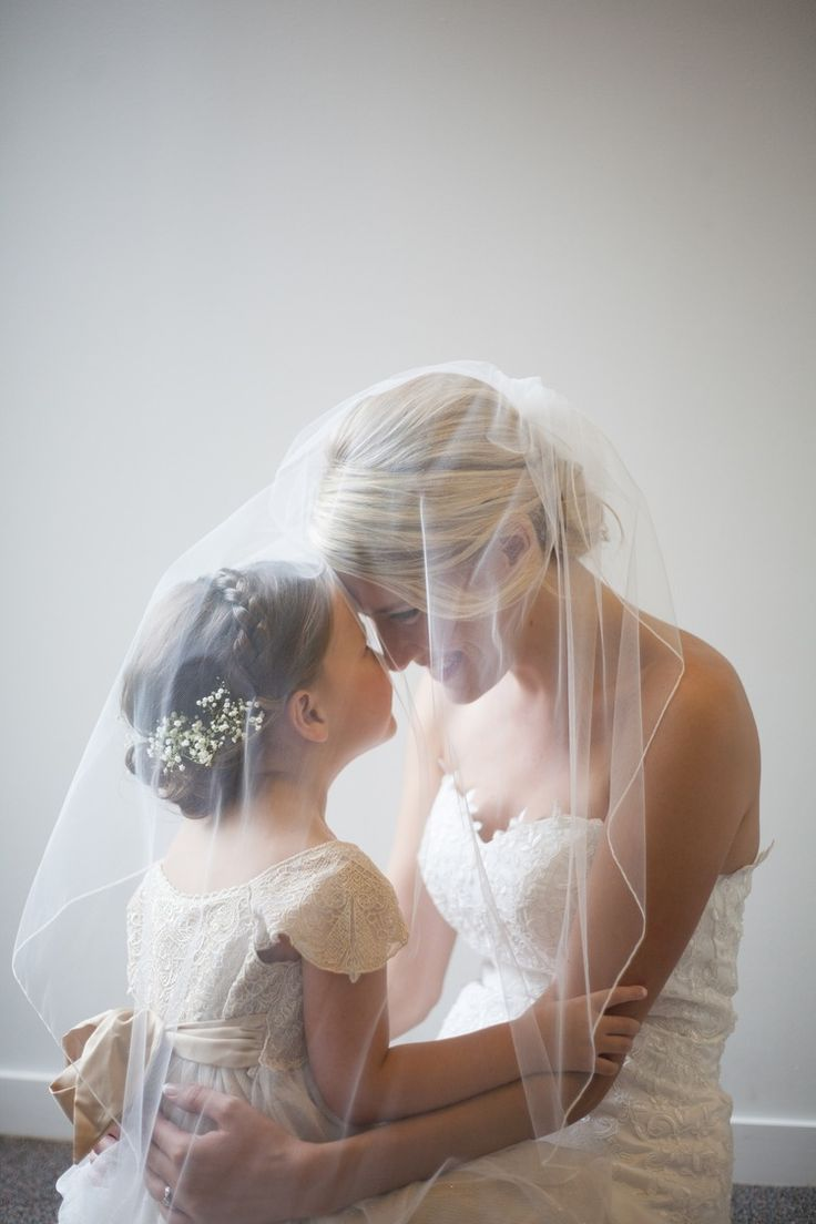 Sweet photo of the bride and flower girl.