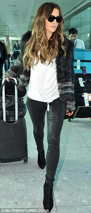 Effortlessly chic: Wrapping up against the chilly winter weather in a black and grey fur coat and in leather trousers