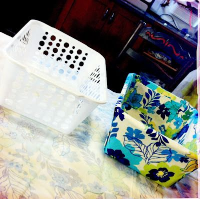 DIY Fabric Covered Bins..Dollar store bin into cute fabric organizer and no sewing. Super easy great idea!