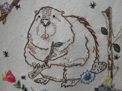 This is a pattern by Andrea Zuill - hand embroidered on a tightly-woven cotten dishtowel.  Her name is Beatrice - Queen of the Dammed. (08/2013)