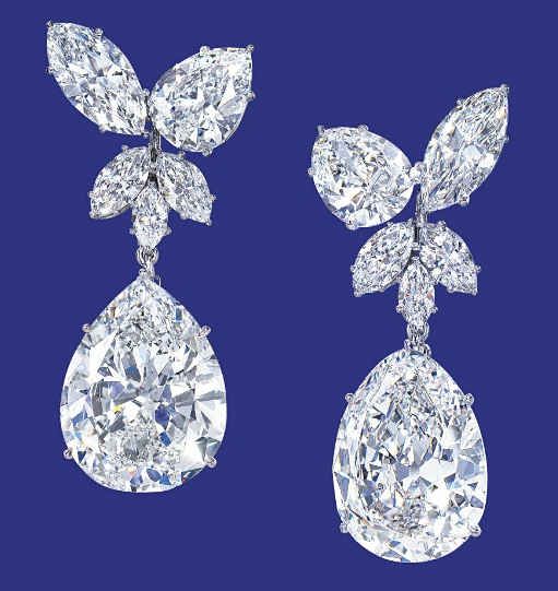 A MAGNIFICENT PAIR OF DIAMOND EAR PENDANTS, BY HARRY WINSTON   Each marquise and pear-shaped diamond cluster earring suspending a detachable pear-shaped diamond weighing 14.38 and 12.75 carats, mounted in platinum, 4.2 cm long    With maker's mark for Harry Winston
