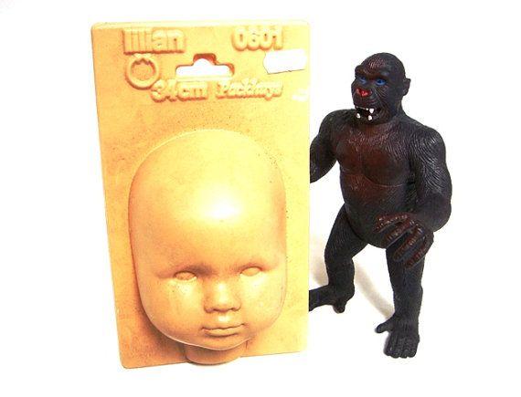 Creepy baby doll head mold by VintageBreda on Etsy, €12.00