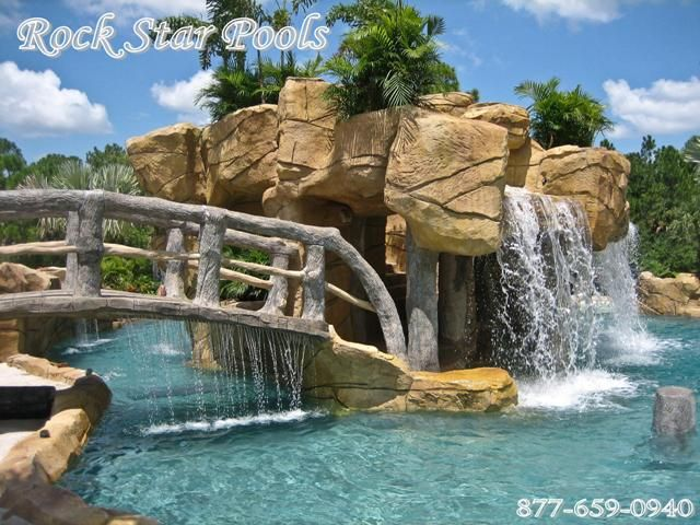 swimming pool lazy river with faux wood stone bridge in naples fl