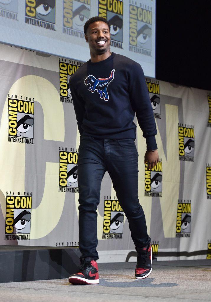 57c0915c4e77 Michael B. Jordan Attends Black Panther Comic Con Panel Wearing A Coach  Sweatshirt And Air Jordan Sneakers