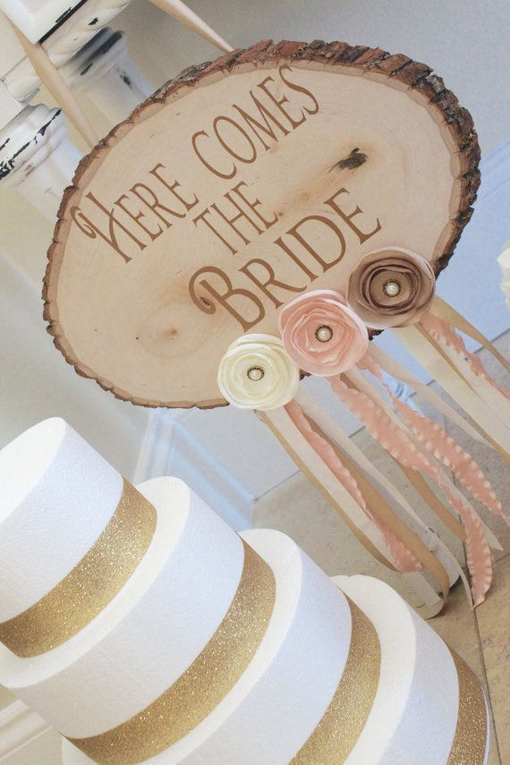 What a show stopper of a wedding sign.  The lettering is done in rose gold outdoor vinyl.  The rustic wood graining is complemented by delicate cream,