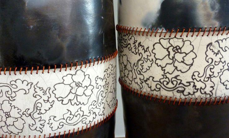 Raku & Smoke Fired. Leather cord seam.