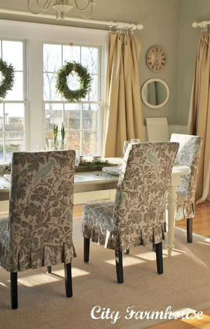 White table with patterned chairs jute carpet greens blue grey