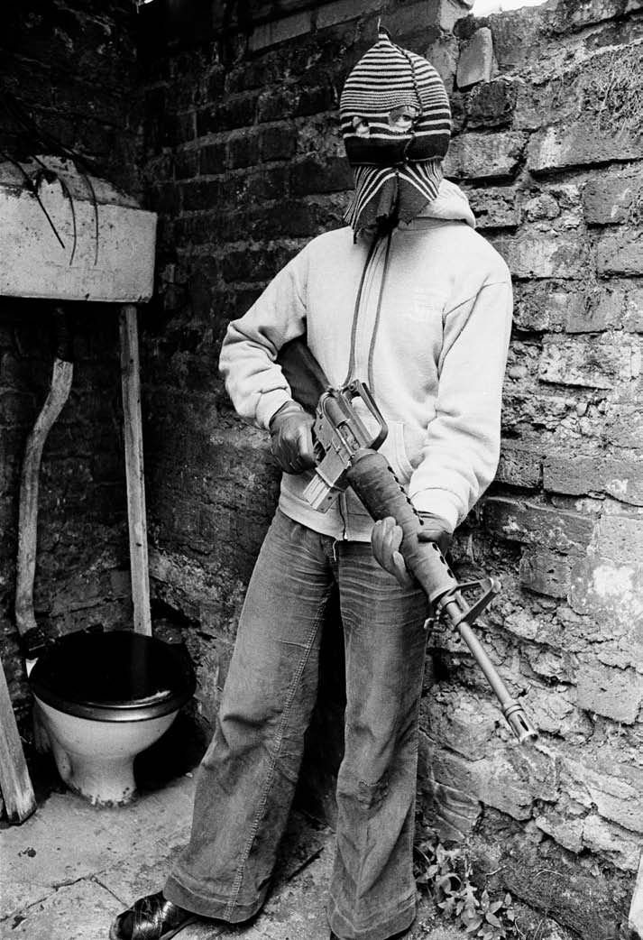 Peter Marlow's Incredible Photos of Eerie Crises | VICE United States  Belfast, Northern Ireland, 1977. A Republican youth with a gun during the Queen's Jubilee riots