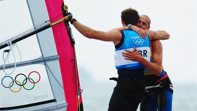 Gold medallist Dorian Van Rijsselberge of Netherlands celebrates with silver medallist Nick Dempsey of Great Britain following the Men's RS:X Sailing on Day 11.