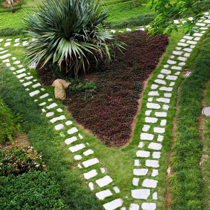 this sparse spaced out flagstone walkway splits around a triangular garden - Sidewalk Design Ideas