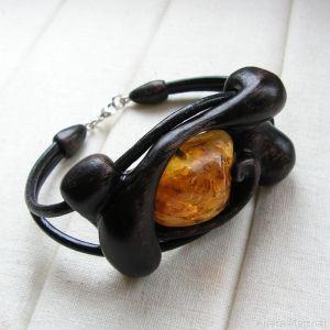 Hand-carved, wooden bracelet with natural baltic amber. Bracelets width: 4cm; circumference of a bracelet: 19cm;