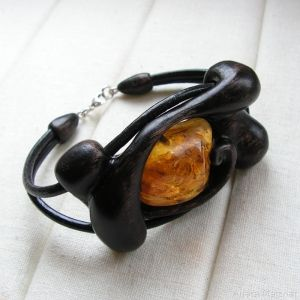 Hand-carved, wooden bracelet with natural baltic amber. Bracelets width: 4cm; circumference of a bracelet: 19cm;
