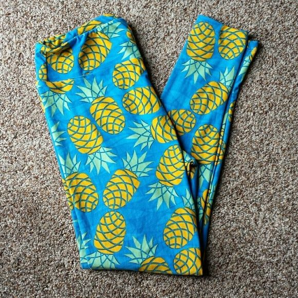 NWOT Lularoe Leggings NWOT Lularoe pineapple leggings in size TC. Never worn got these and just didn't want them. They are super cute and love the print! If your new to Lularoe the TC size can fit a pant size 12-20. LuLaRoe Pants Leggings