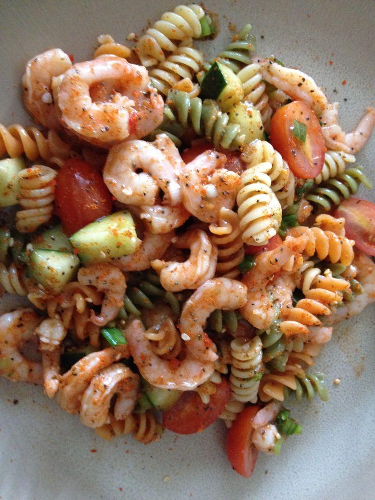 Pasta salad with shrimp, grape tomatoes, cucumber, scallions, salad supreme seasoning, and bell pepper Italian salad dressing.