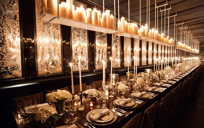 A trend in high-end events are dinner tables without linens.  If you visit my website, you can see what this space looked like before we started!