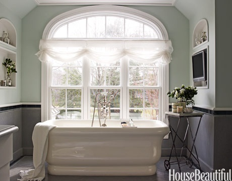 Dream window, dream tub, and a place for a TV to boot.  Prune city!