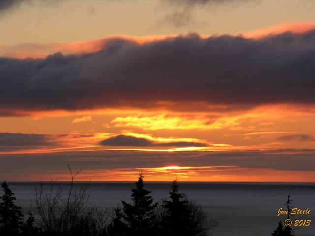 Another grey start to the day in Cape Breton. The woodpeckers have lost hope for sunshine. This morning they were replaced by an owl. Here's a beautiful sunrise from May 14, 2010. A big thanks to Jim Steele for putting some sunshine into our day.