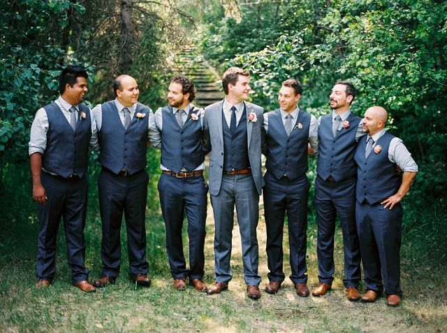 blue and grey groomsmen outfits. vests only. brown and blue groomsmen suits