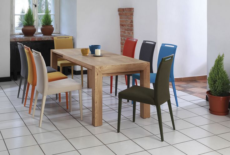 Color is everything. Colorful S44 chairs design by Klose. #DinningRoomFurniture #KloseFurniture #tablesets
