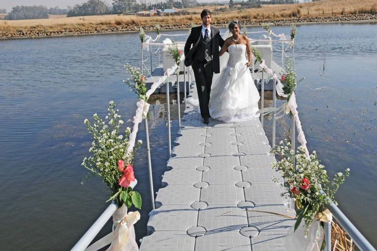 Bride and Bridegroom using a DOCKPRO jetty as a wedding aisle. info@dockpro.co.za | www.dockpro.co.za