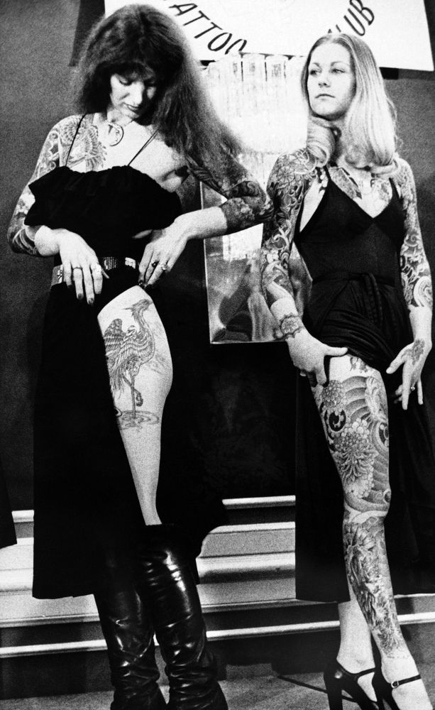 """Madam Lazonga, left, who is a tattoo artist in Seattle Wash., gets a cool look from Barbara Chapman, Denver Colorado, after it was announced that Ms. Lazonga had been chosen """"most beautifully tattooed female"""" by the American Tattoo Club at their third world convention at the Hotel in St. Paul on Jan. 28, 1978."""