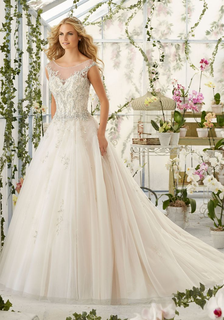Intricate Crystal Beaded Embroidery Decorates the Tulle Ball Wedding Dress. Colors available:White/Silver, Ivory/Silver and Light Gold/Silver.
