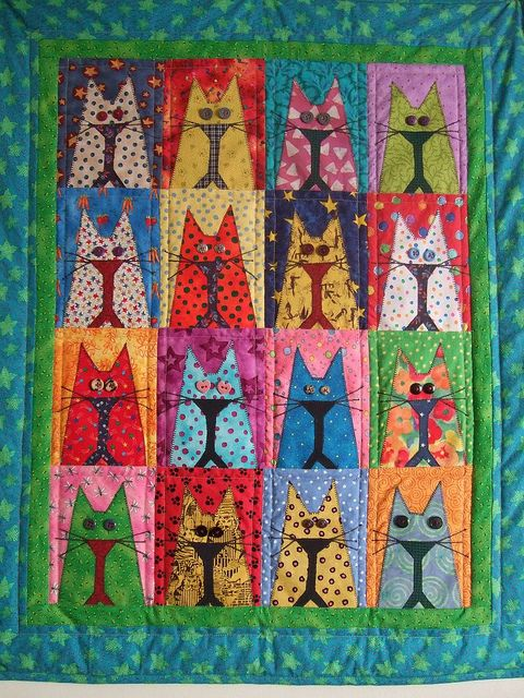 cat quilt with button eyes